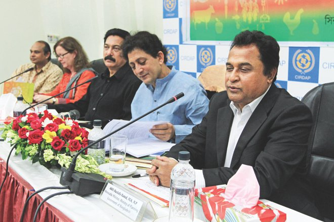Planning Minister AHM Mustafa Kamal speaks at a seminar on social protection for food security organised by USAID-funded Shouhardo II programme of CARE Bangladesh, in Dhaka yesterday. Photo: Star