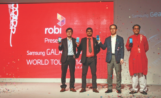 Officials of Robi and Samsung Bangladesh pose during the launch of Galaxy S5, Samsung's latest flagship device, at a programme yesterday. The device will be available in the market from today. Photo: Robi