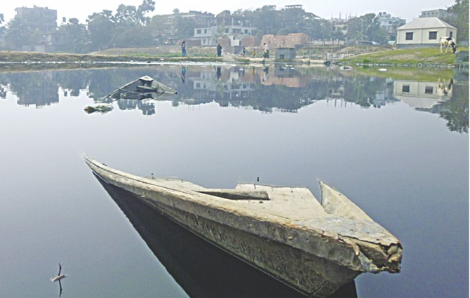 What was once a canal bubbling with life and bringing prosperity to communities in Savar is now a mass of mud, algae and garbage peering over murky waters with only a broken boat to signify its history. Photo: Rashad Ahamad