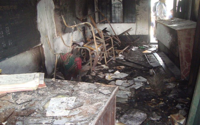 The remains of the furniture of Mamunshia Govt Primary School in Kotchandpur of Jhenidah after criminals torched the school ahead of the January 5 polls. Photo: Star