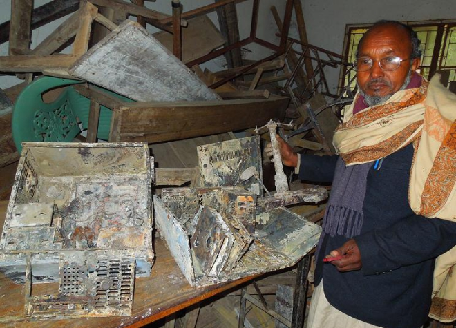 Azizul Islam, retired headmaster of the school, shows valuables including furniture, computers and multimedia equipment destroyed in the barbaric act. PHOTO: STAR