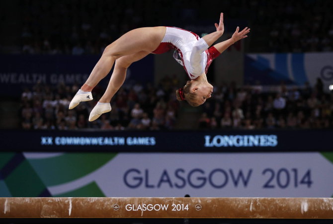 Elsabeth Black of Canada performs on the beam during the women's gymnastics apparatus final at the Commonwealth Games in Glasgow yesterday. She won gold in the event. PHOTO: REUTERS