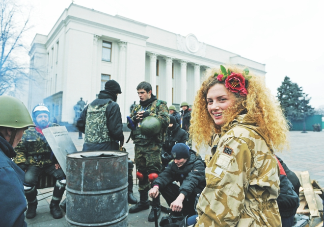 Maidan self-defence activists guard at the Ukraine parliament during the session in Kiev. While Ukraine's opposition-dominated parliament yesterday delayed the highly-anticipated formation of a new government until tomorrow, it voted to apply to the International Criminal Court to prosecute Yanukovych over the