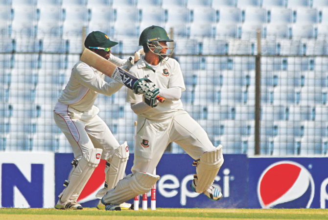 Ace Bangladesh all-rounder Shakib Al Hasan follows through on a back-footed cut during his fluent knock of 71 against Zimbabwe on the second day of the third and final Test at Chittagong yesterday. The Tigers piled up 503. In reply, the visitors were 113-1 at stumps. PHOTO: ANURUP KANTI DAS