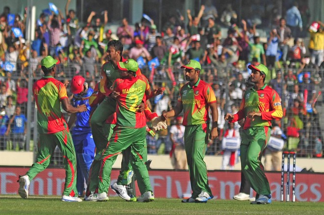 Bangladesh's ace all-rounder Shakib Al Hasan is the toast of his teammates after taking one of his three wickets which restricted Afghanistan to 72 in the opening fixture of the World T20 at the Sher-e-Bangla National Stadium in Mirpur yesterday. PHOTO: firoz ahmed