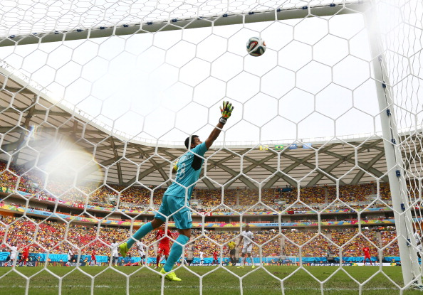 Xherdan Shaqiri of Switzerland (ground) scores his team's first goal past goalkeeper Noel Valladares of Honduras during the 2014 FIFA World Cup Brazil Group E match between Honduras and Switzerland at Arena Amazonia on June 25, 2014 in Manaus, Brazil. Photo: Getty Images