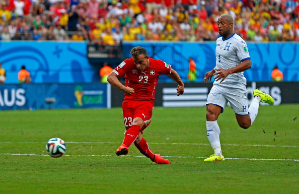 Xherdan Shaqiri of Switzerland shoots and scores his team's second goal during the 2014 FIFA World Cup Brazil Group E match between Honduras and Switzerland at Arena Amazonia on June 25, 2014 in Manaus, Brazil. Photo: Getty Images