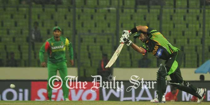 Pakistan centurian Ahmed Shehzad drives away a delivery on his 103-run knock against Bangladesh in an Asia Cup match at capital's Mirpur today. Photo: Firoz Ahmed