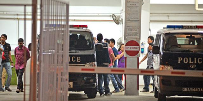 Police arrest 35 foreign workers involved in a fight at Homestay Residences at Kaki Bukit Avenue 3 on March 25. Eight Bangladeshi workers have been cleared of the dormitory riot - which is thought to have erupted over the result of a cricket match. This photo is taken from The Straits Times.