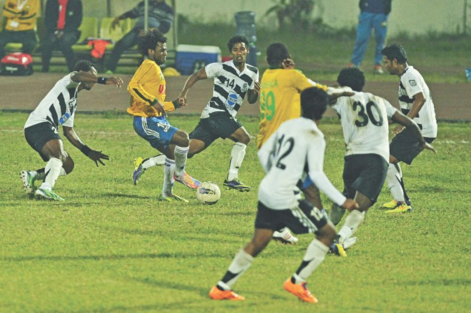 Sheikh Jamal DC's Haitian forward Sony Norde (2nd from L) is surrounded by five Mohammedan players as he tries to advance during their Bangladesh Premier League match at the Bangabandhu National Stadium yesterday.  PHOTOS: STAR