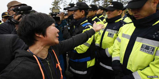Tempers have flared at times between relatives of those on board and police