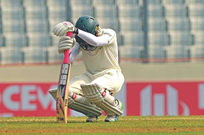 Bangladesh captain Mushfiqur Rahim puts his head down in dismay, at Mirpur, after the hosts lost the crucial wicket of Mominul Haque in the post-lunch session yesterday. The Tigers were bundled out for 250 on the fourth day of the first Test and went down to Sri Lanka by an innings and 248 runs -- their fourth worst innings defeat. The match saw the Tigers leak 730 runs in one innings. It was a flow-stopper for the Tigers', who had otherwise had a good run in the last two years. Photo: Star
