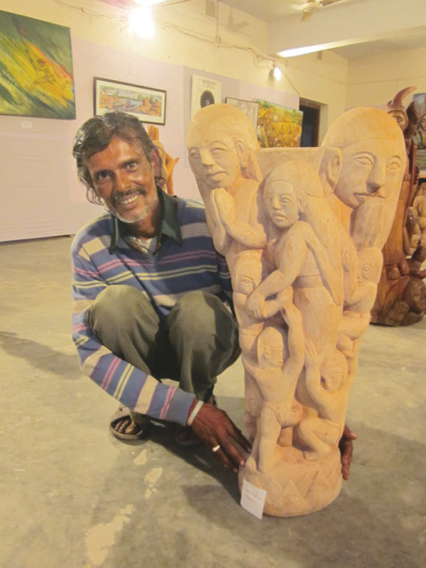A participating artist at the SM Sultan Utsob 2014 poses with his Christianity inspired sculpture. Photo: Andrew Eagle