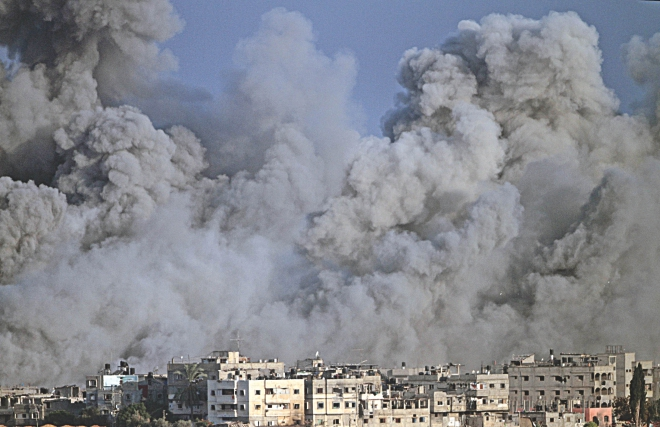 Humanitarian  Crisis  In  Gaza: Smoke and debris fill the air during an Israeli strike on Gaza City early yesterday. Photo: AFP