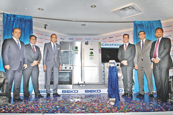Hüseyin Müftüoğlu, Turkish ambassador to Bangladesh; Gavin Walker, president of Singer Asia; AM Hamim Rahmatullah, managing director of Singer Bangladesh, and Gurhan Gunal, project manager for international sales of Arçelik AS, attend the launch of Arçelik's Beko and Grundig brands in Bangladesh through Singer, at Sonargaon Hotel in Dhaka yesterday.  Photo: Star
