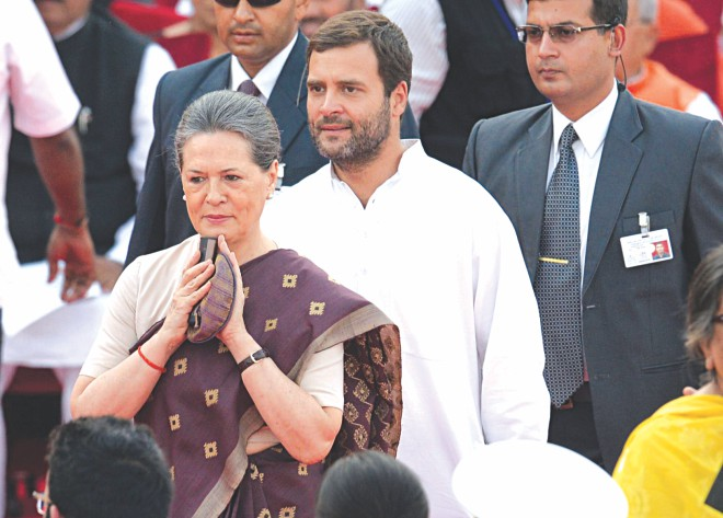Congress Party President Sonia Gandhi (L) and her son and party Vice President Rahul Gandhi arrive at the swearing-in ceremony for new Indian Prime Minister Narendra Modi at the Presidential Palace.  Photo: AFP