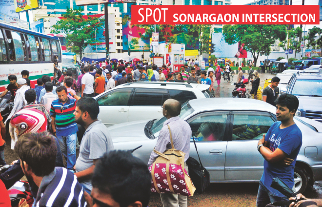 A large number of pedestrians, walking through the busy Sonargaon intersection in the capital, obstruct the normal flow of traffic. Though there is an underpass [not in the frame] nearby, these pedestrians carefully ignore it. The photo was taken around 4:30pm yesterday. Photo: Firoz Ahmed