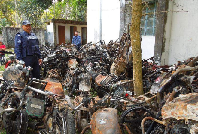 This file photo shows wreckage of 39 burnt motorbikes of the activists of Awami League and its front organisations, bearing testimony to the extent of barbaric attack on a December 14 march led by AL lawmaker Asaduzzaman Noor near Ramganj, eight km off Nilphamari town, is kept on the premises of Nilphamari Sadar Police Station