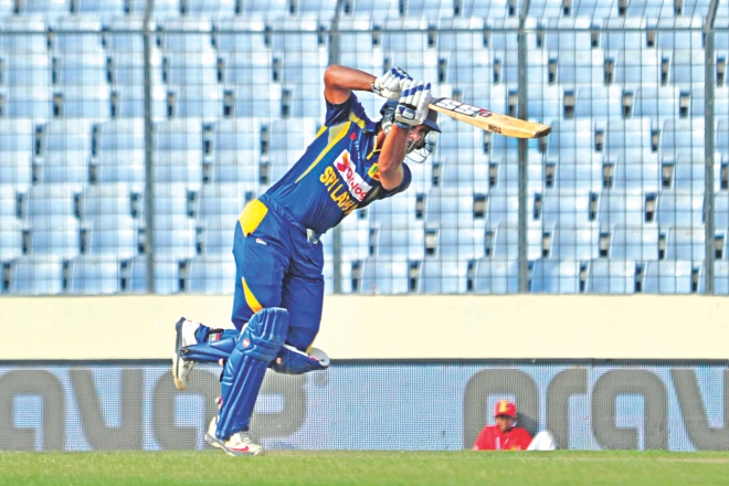 Sri Lanka superstar Kumar Sangakkara drives off the front foot on way to making a solid 76 against Afghanistan in their Asia Cup match at the Sher-e-Bangla National Stadium in Mirpur yesterday. In today's match of the tournament, Bangladesh will take on Pakistan at the same venue. PHOTO: FIROZ AHMED