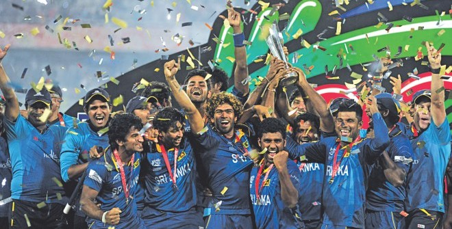 CLASS OF 2014: Members of the victorious Sri Lanka cricket team celebrate with the ICC World Twenty20 trophy at the Sher-e-Bangla National Stadium in Mirpur yesterday. The Lankans won the final against India by six wickets. Photo: FIROZ AHMED