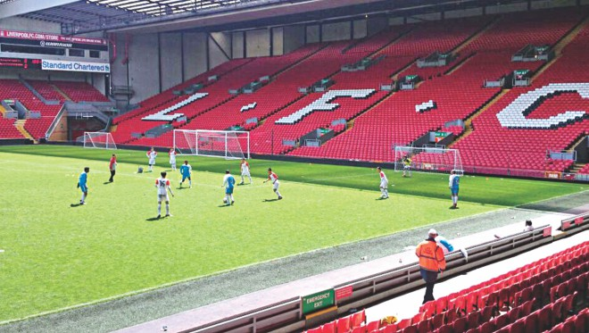 Action from the Standard Chartered Trophy match between Bangladesh's Grameenphone and Hong Kong's SFALO Limited at Anfield on Tuesday morning. PHOTO: COURTESY