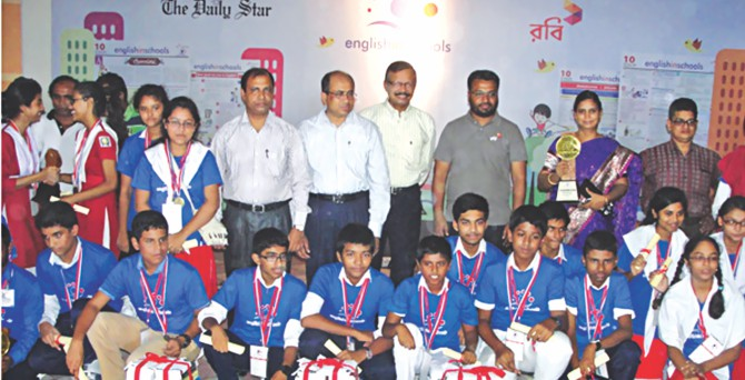Winners of Khulna divisional round of English in Schools, a joint programme of The Daily Star and Robi, along with guests, from left, TM Jakir Hossain, deputy director of The Directorate of Secondary and Higher Education, Khulna; Anis Mahmud, deputy commissioner of Khulna; Dr Salehuddin Ahmed, managing editor of The Daily Star, and Arifur Rahman, area manager of Robi, Khulna district, in Khulna Saint Joseph High School's auditorium yesterday. Photo: Star