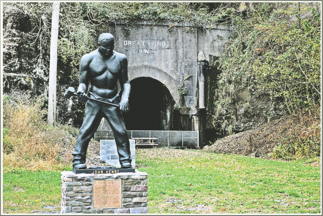 John Henry statue, with the legendary tunnel in the background, in Talcott, West Virginia.