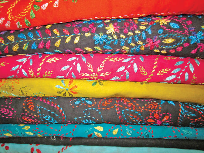 Colours and design have empowered the women of Jamalpur to take a leading role in bettering their families' futures and developing their communities. Photo: Endrew Eagle