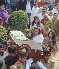 Suchitra's coffin being carried away