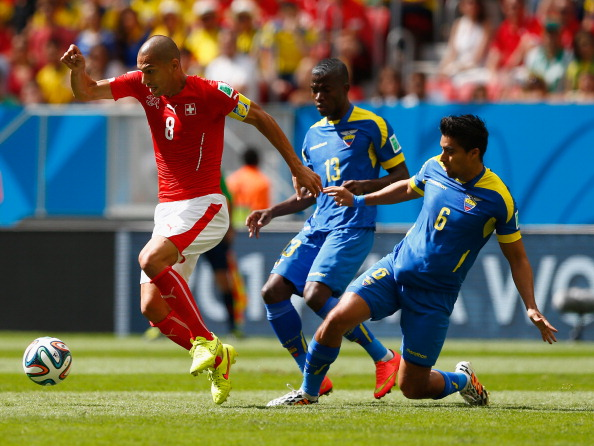 Gokhan Inler of Switzerland is challenged by Enner Valencia (C) and Christian Noboa of Ecuador during the 2014 FIFA World Cup Brazil Group E match between Switzerland and Ecuador at Estadio Nacional on June 15, 2014 in Brasilia, Brazil. Photo: Getty Images