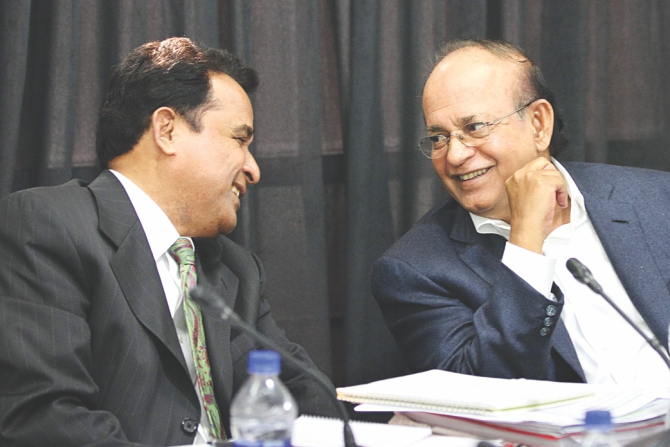 Planning Minister AHM Mostafa Kamal and Environment and Forest Minister Anwar Hossain Manju, inset, share a light moment during a roundtable, 'Development of Southwest Region and Protecting the Sundarbans', organised by The Daily Star at The Daily Star Centre in the capital yesterday.