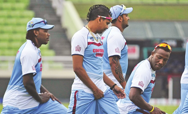 West Indies leg-spinner Sunil Narine, with a Mohawk-haircut, trains with the other members of his team at the Sher-e-Bangla National Stadium in Mirpur yesterday, ahead of their crucial ICC World T20 match against hosts Bangladesh today. Photo: Firoz Ahmed