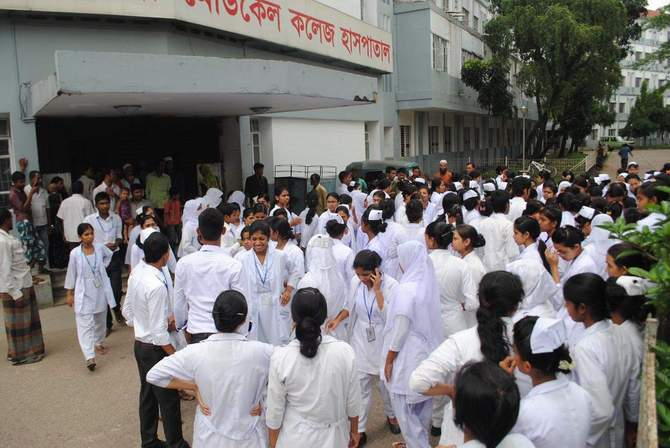 Students of Sylhet Nursing College demonstrate in front of Sylhet MAG Osmani Medical College Hospital Monday, protesting an attack on some of them, allegedly by interns of the hospital. Photo: Star
