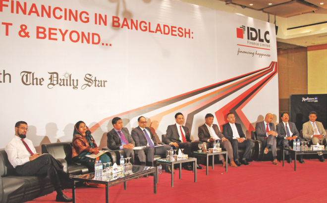 Officials of banks and other financial institutions take part in a seminar on syndicated financing, organised by IDLC Finance in partnership with The Daily Star at Radisson Hotel in Dhaka on Wednesday. Photo: IDLC