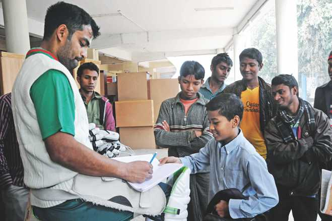 Star batsman Tamim Iqbal complies with autograph hunters during a break in training at the Sher-e-Bangla National Stadium in Mirpur yesterday. Photo: STar