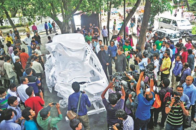 A memorial installation made out of the wreckage of the microbus filmmaker Tareque Masud and media personality Mishuk Munier had been riding, just before a tragic collision took their lives in Manikganj three years ago. The artwork dedicated in the memory of all road accident victims of the country was inaugurated on the Dhaka University campus yesterday.  Photo: Star
