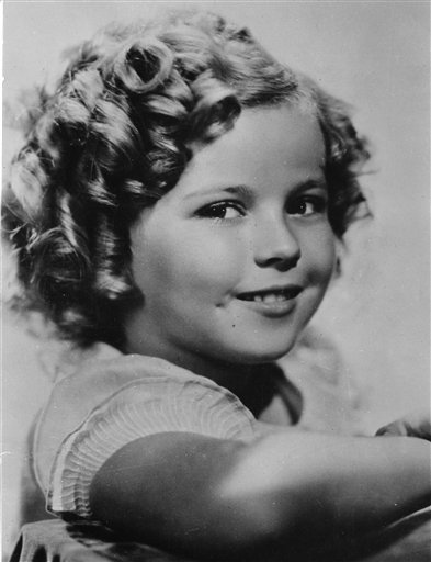 In this Nov 1936 file photo, 8-year-old US American child movie star Shirley Temple is portrayed in Hollywood, Ca., USA. Shirley Temple, the curly-haired child star who put smiles on the faces of Depression-era moviegoers, has died. She was 85. Photo: AP