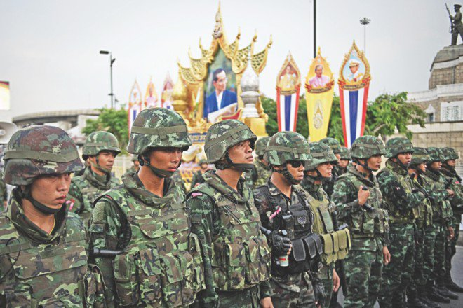 Thai soldiers take control of an area during the anti-coup protest. Thailand's coup leader received royal endorsement to lead the politically divided kingdom on May 26 and quickly issued a stark warning that he would brook no further opposition to his takeover following a weekend of angry protests.
