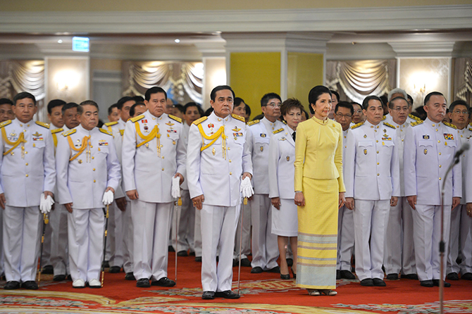 Thailand's newly appointed Prime Minister Prayuth Chan-ocha stands with his wife Naraporn during the royal endorsement ceremony at the Royal Army headquarters in Bangkok in this August 25, 2014 handout photo provided by the Thailand Government House. Photo: Reuters