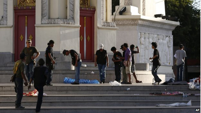 Protesters cleaned the steps of the Democracy Monument in Bangkok on Thursday morning