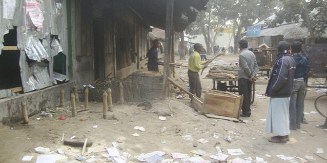 In this January 7 photo, people looking at damaged shops belonging to Hindu community people as BNP and Jamaat-e-Islami men vandalised and looted the shops at Deunia bazar of Gopalpur village in Thakurgaon.