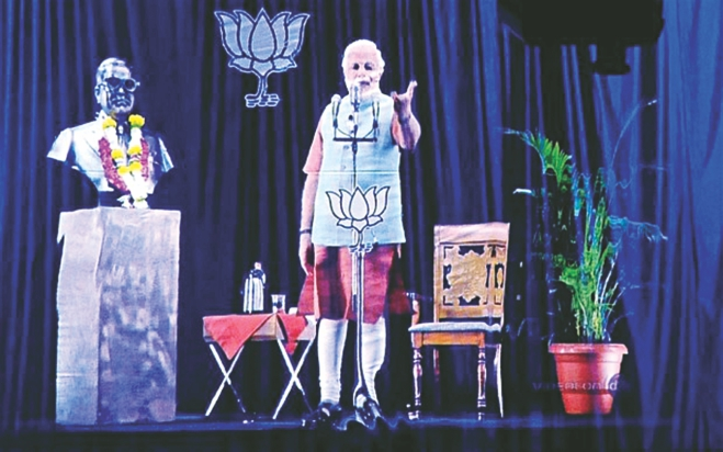 The holographic image of Modi addressing a rally in Mumbai. Photo: AFP