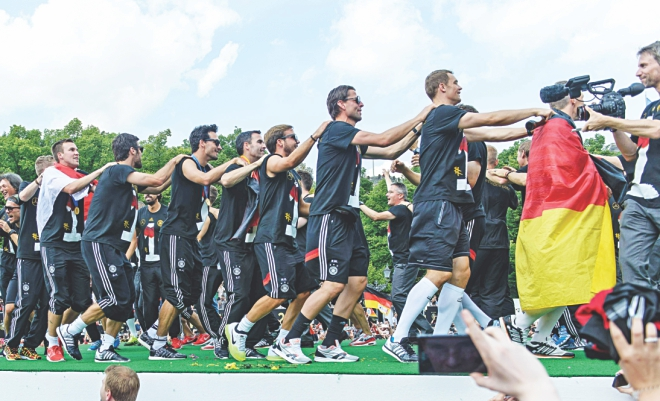While the players dance a conga during the victory parade at landmark Brandenburg Gate. PHOTOS: REUTERS
