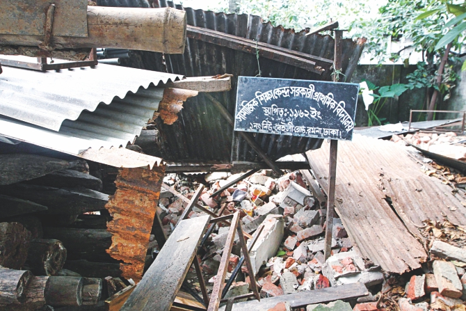 Only the sign board of the school still remains standing amid the rubble of the razed structure.  Photo: Palash Khan