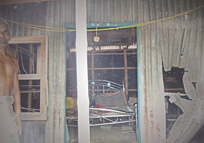 The vandalised homes of Hindus at Demra Bazar area in Faridpur upazila in Pabna. A mob went on the rampage there yesterday after a Hindu man had allegedly attempted to assault a girl. Photo: Star