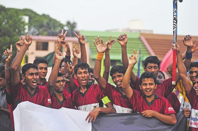 The victorious Al Hikma School of Rajshahi celebrate their win over Jessore Municipal Preparatory School in the final of the First Security Islami Bank National School Hockey Championship at the Maulana Bhasani Hockey Stadium yesterday. PHOTO: STAR