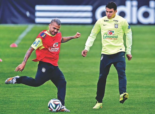 Brazil's Daniel Alves (L) and Thiago Silva take part in a training session in Teresopolis on Thursday as they prepare to take on the Netherlands in the play-off today. PHOTO: GETTY IMAGES