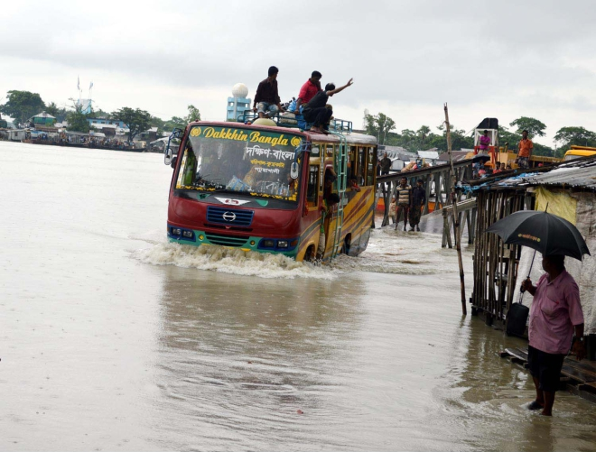The gangways at Hajipur, Mohipur and Kalapara ferry terminals on Patuakhali-Kuakata road have gone under water due to tidal surge yesterday. This photo was taken from Nilganj end of Kalapara terminal.  Photo: Star