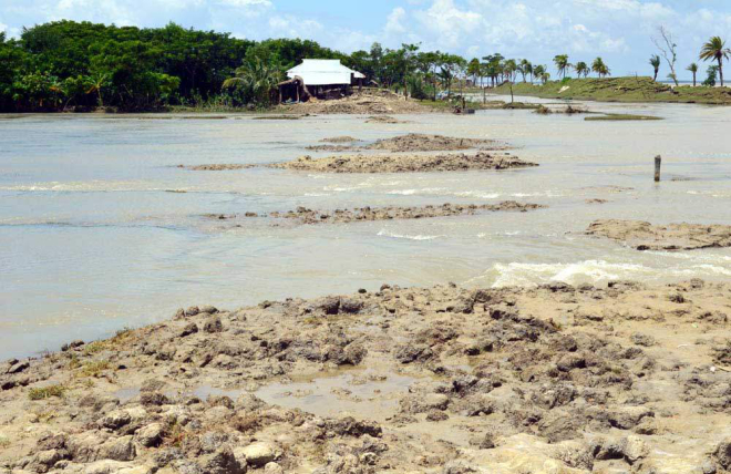High tide affected by the full moon presently floods 13 villages of Lalua union in Kalapara upazila under Patuakhali district every day.  PHOTO: STAR