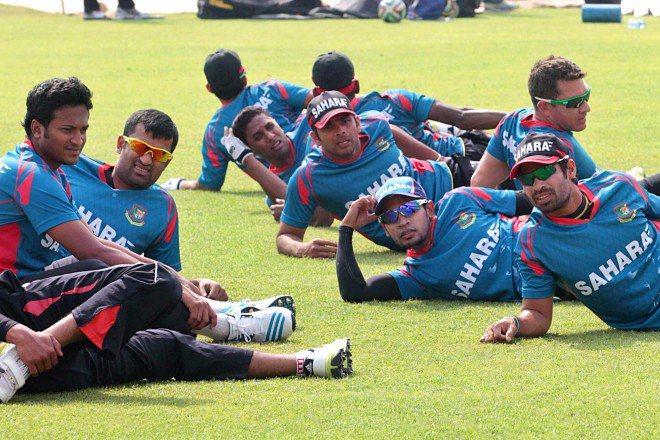 The Tigers sporting their new kit limber up for a training session at the Sher-e-Bangla National Stadium in Mirpur yesterday.  Photo: SK. Enamul Haq